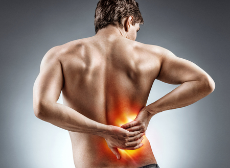 Man holding his back. Kidneys pain. Medical concept.