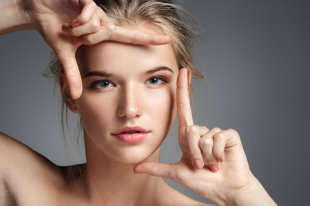 Photo pour Close up face of pretty girl. Photo of blonde girl with perfect skin on grey background. Youth and Beauty - image libre de droit