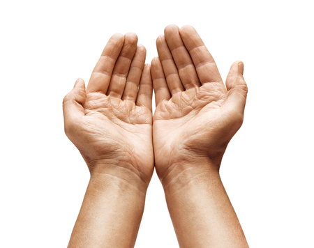 Photo for Close up of man's cupped hands shows something on white background. Palms up. High resolution product - Royalty Free Image