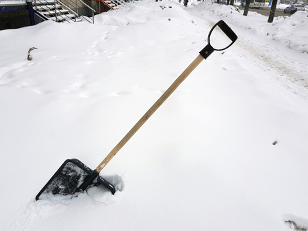 Photo for Beautiful snow shovel and ice ax stuck in the snow in winter - Royalty Free Image