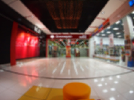 Wide angle distortion view from interior of the shopping center was blurred for use as a background
