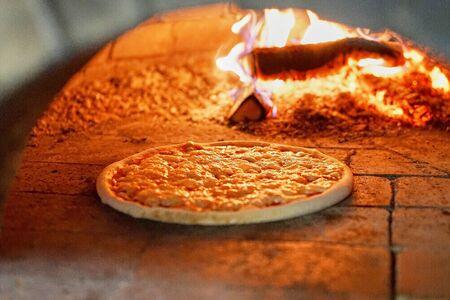 Photo pour Pizza baking in the oven - image libre de droit