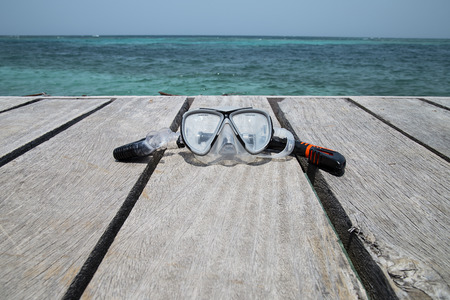 Mask and Snorkel Set on a deck in the beach Rosario Islands Colombia