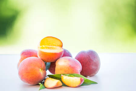 Organic cultured ripe peach fruits