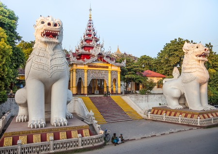 Mandalay, Myanmar-12 December, 2015. Southern stairway with its magnificent guardian chinthe at the entry to Mandalay hill pagodas on 12 December, 2015 in Mandalay.