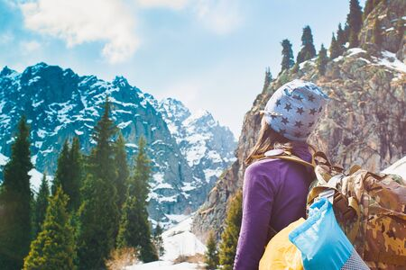Photo for Traveling girl with backpack hiking in the mountains, freedom concept. Hiking people on Asia. Beautiful young woman traveler with a backpack looks at the mountain top before climbing - Royalty Free Image
