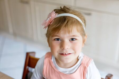 Photo for Portrait of adorable cute toddler girl of three years. Beautiful baby with blond hairs looking and smiling at the camera. Happy healthy child. - Royalty Free Image