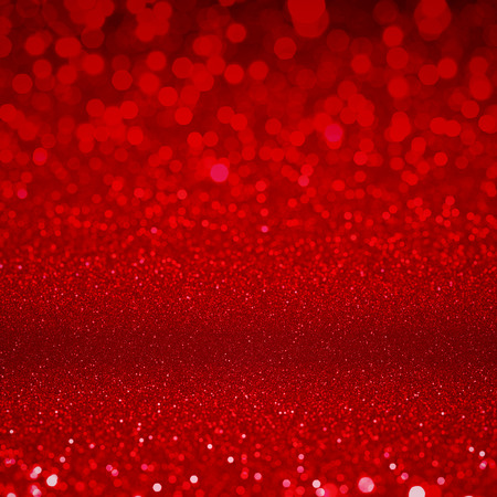 Red glitter sparkles. Textured christmas sequins background. Fashion glamour ruby glittering wallpaper