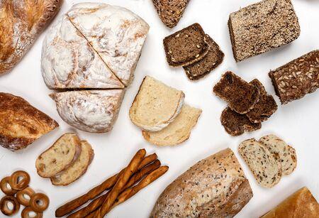 Foto für Different types of bread on a white background. Top view. - Lizenzfreies Bild