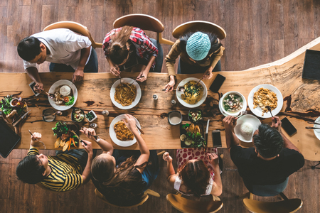 Photo pour Group of happy friends having nice food and drinks, enjoying the party and communication, Top view of Family gathering together at home for eating dinner. - image libre de droit