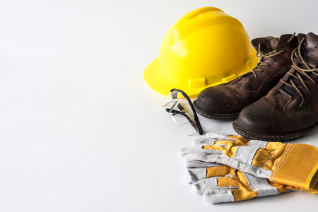 Foto de Construction site safety. Personal protective equipment on white background. Free space for text - Imagen libre de derechos