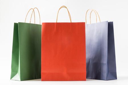 Photo pour Colourful paper shopping bags on white background - image libre de droit