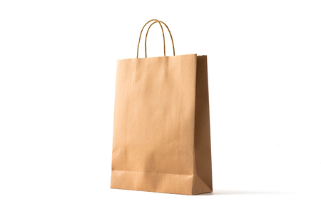 Foto de Brown paper shopping bag on white - Imagen libre de derechos