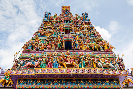 Intricate Hindu art and deity carvings on the facade of Sri Veeramakaliamman Temple in Little India Singapore.