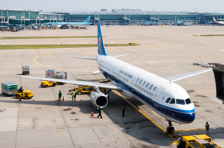 A China Southern Airlines plane being serviced on the tarmac of Tokyo Narita Airport. Headquartered in Guangzhou, China, the airlines is the world's sixth-largest measured by passengers carried and Asia's largest airline in fleet size and passengers carri