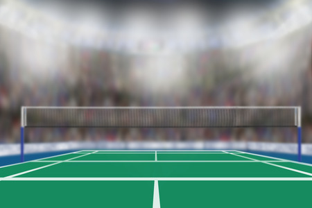 Photo pour Low angle view of badminton arena with sports fans in the stands and copy space. Focus on foreground with deliberate shallow depth of field on background. - image libre de droit