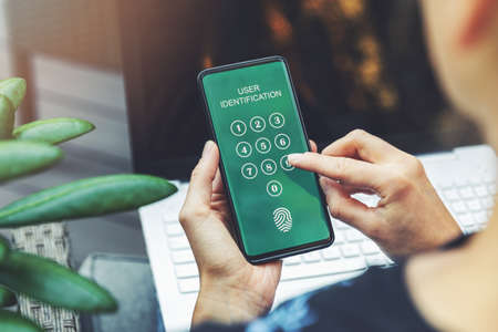 Photo pour cyber security - woman using mobile application in smartphone for internet banking user authentication - image libre de droit
