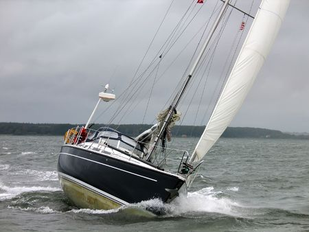 Yacht racing in a windy dark winter day
