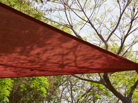 Colorful shade net shaped like a triangle in a park
