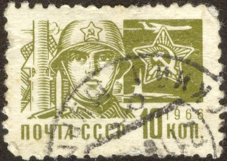 The soldier of the Soviet army.  The scanned Soviet stamp.
