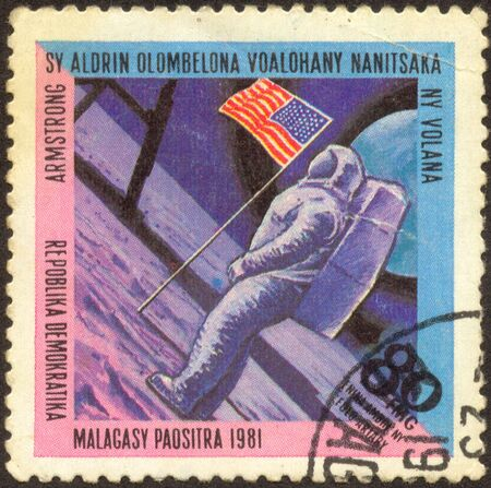 The scanned stamp. Armstrong the first person visited the moon.