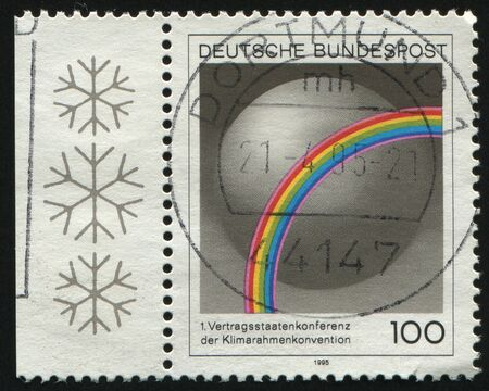 GERMANY- CIRCA 1995: stamp printed by Germany, shows emblem Conf. of General Convention on Climate, Berlin, circa 1995.