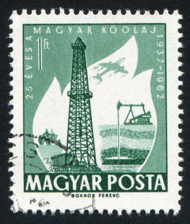 HUNGARY – CIRCA 1962: stamp printed by Hungary, shows Oil Derrick and Primitive Oil well, circa 1962
