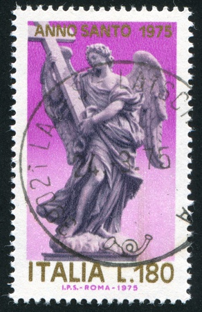 ITALY - CIRCA 1975: stamp printed by Italy, shows Angel with Cross, circa 1975