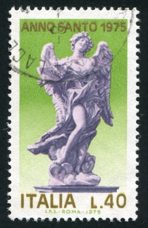 ITALY - CIRCA 1975: stamp printed by Italy, shows Angel with Tablet, circa 1975