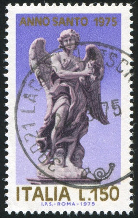 ITALY - CIRCA 1975: stamp printed by Italy, shows Angel holding Crown of Thorns, circa 1975