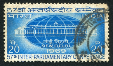 INDIA - CIRCA 1969: stamp printed by India, shows Globe and Parliament, circa 1969