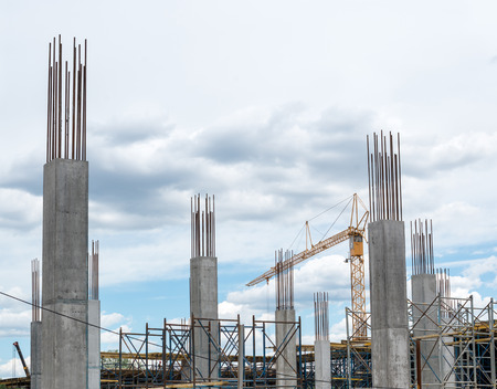 Photo for Reinforced concrete piles of the new building and tower crane behind them. - Royalty Free Image