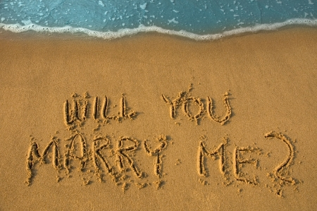 will you marry me written in sand, cyan water