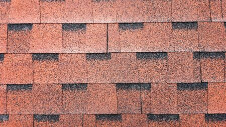 Photo for Close up view on Asphalt Roofing Red Shingles Background. Roof Bitumen Shingles - Roofing Construction, Roofing Repair. Red Shingles on the Roof of the House. Background of Red Shingles. - Royalty Free Image