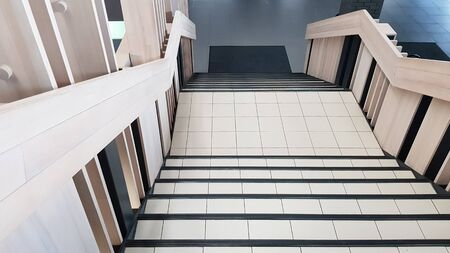 Photo pour top view down stairs of tile and light wood indoors. - image libre de droit