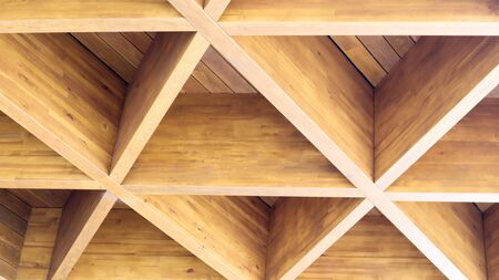 Photo pour Luxurious geometric wooden triangles in construction. The concept of modern architecture, design and interior. Wood background. Modular canopy or roof - image libre de droit