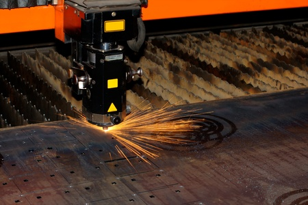 Industrial laser with sparks flyiing around (with copy space)