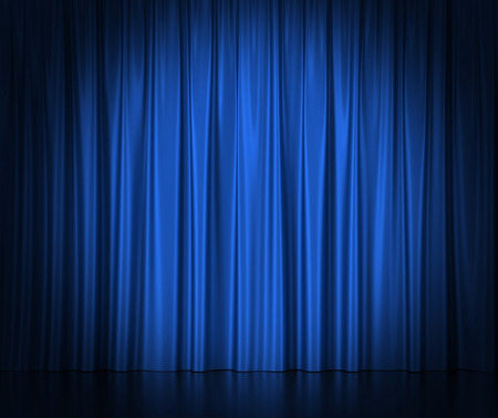 Blue silk curtains for theater and cinema spotlit light in the center