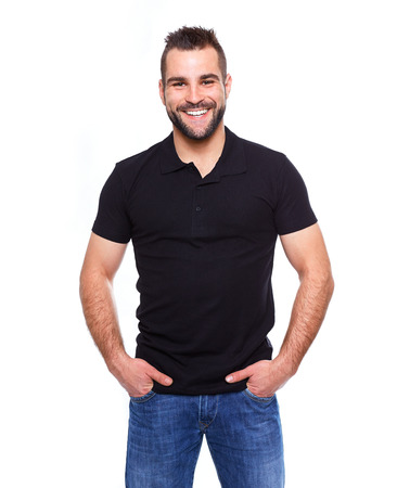 Young happy man in a black polo shirt on white background