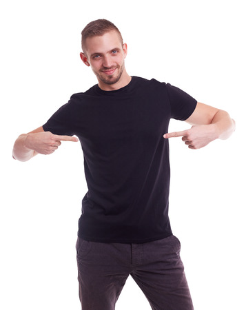 Handsome man showing empty copyspace on black t shirt