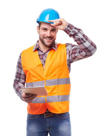 Photo for Manual worker in blue helmet with digital tablet, isolated on white. - Royalty Free Image