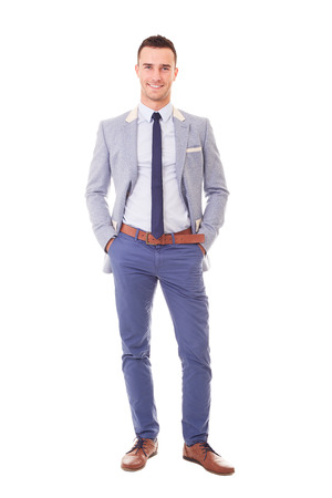 Portrait of smiling businessman with hands in pockets, isolated on white background