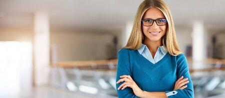 Photo pour Happy businesswoman with glasses in business center - image libre de droit