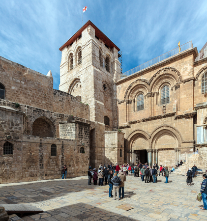 JERUSALEM, ISRAEL - FEBRUARY 15, 2013: Tourists entering main entrance of Holy Sepulchre Cathedral