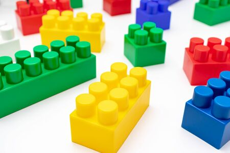 Photo pour Many colorful toy plastic bricks, kit of blocks for building and constructing on white background, Children's game and playing concept. - image libre de droit