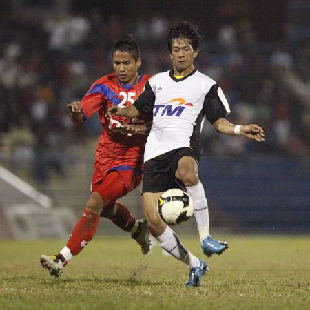 TERENGGANU, MALAYSIA - JANUARY 30: Firdaus Faudzi of Terengganu (right) and Ahmad Dashila of Kuala Lumpur (left) in action during their Malaysian Super League match January 30, 2010 in Terengganu, Malaysia