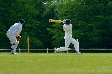 A cricket batsman playing a pull shot