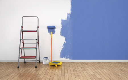 Painting walls in empty room. Renovation house