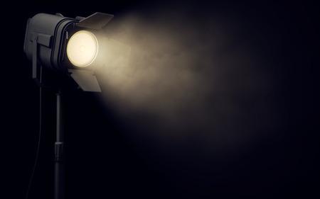 Photo pour Warm stage spotlight shines in dark background - image libre de droit