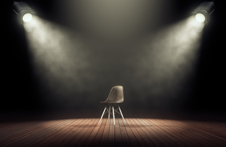 Photo pour Spotlights illuminate empty stage with chair in dark background. 3d rendering - image libre de droit
